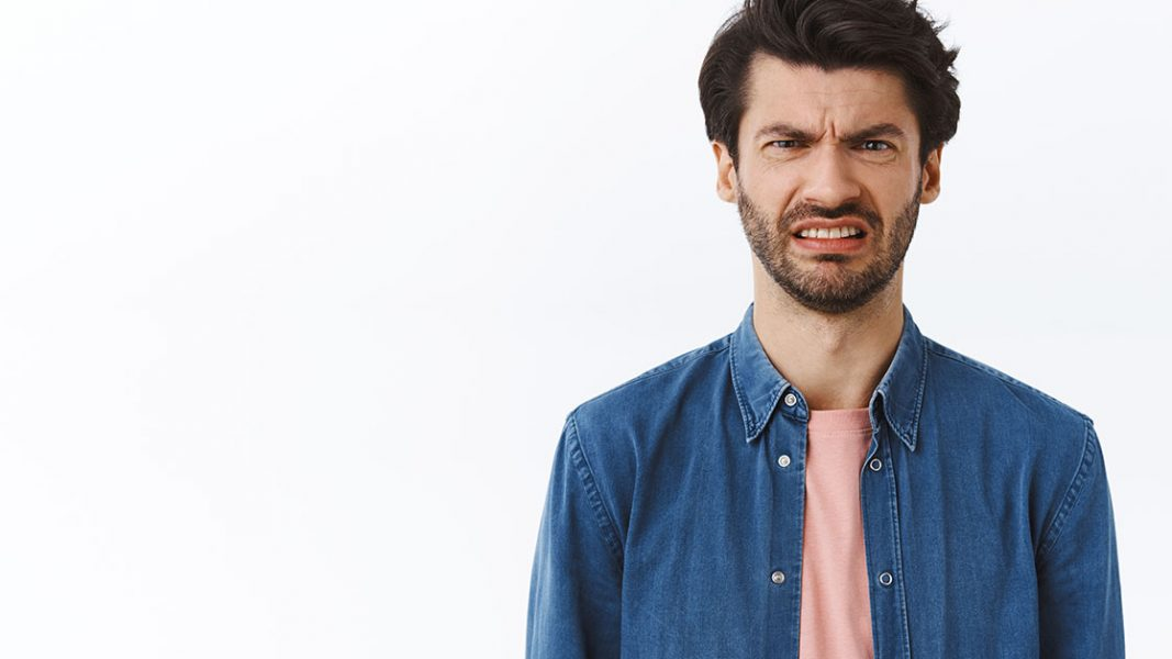 Awkward hospitality worker feigns sadness upon news he must claim Jobsaver stimulus